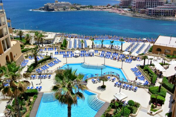 Alfa Sun Loungers in Blue and White – Pictured in Hotel Pool Setting