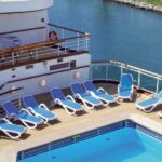 Alfa Sun Loungers in Blue and White – Pictured on the Deck of Cruise Ship by Pool (Another View)