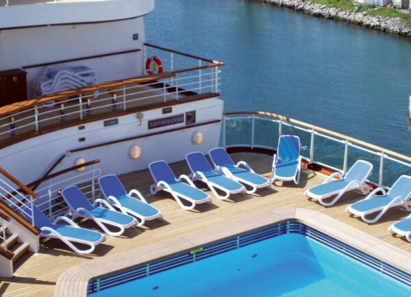 Row of Alfa Sun Loungers in Blue and White on cruise ship deck