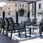 Aria Luxury Patio Armchairs (Charcoal with Grey Cushions) - Pictured in an Indoor Office Setting