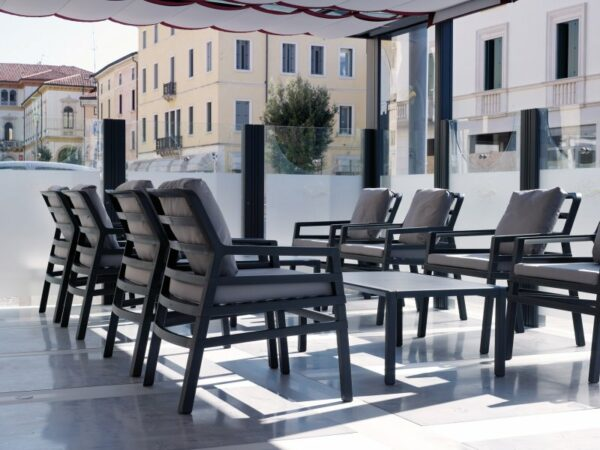 Aria Luxury Patio Armchairs (Charcoal with Grey Cushions) – Pictured in an Indoor Office Setting