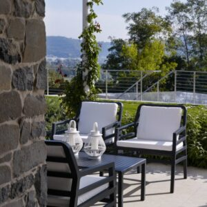 Aria Luxury Patio Armchairs (Charcoal with White Cushions) – Pictured in an Outdoor Patio Setting