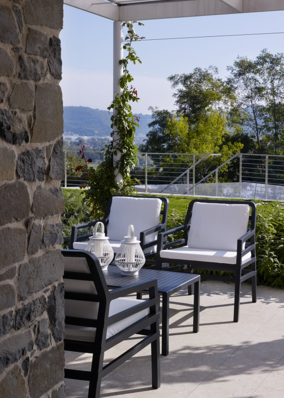 Aria Luxury Patio Armchairs (Charcoal with White Cushions) - Pictured in an Outdoor Patio Setting