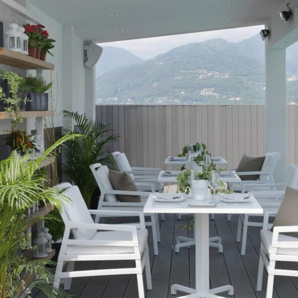 Aria Luxury Patio Armchairs (White with White Cushions) – Pictured in Cafe Deck setting