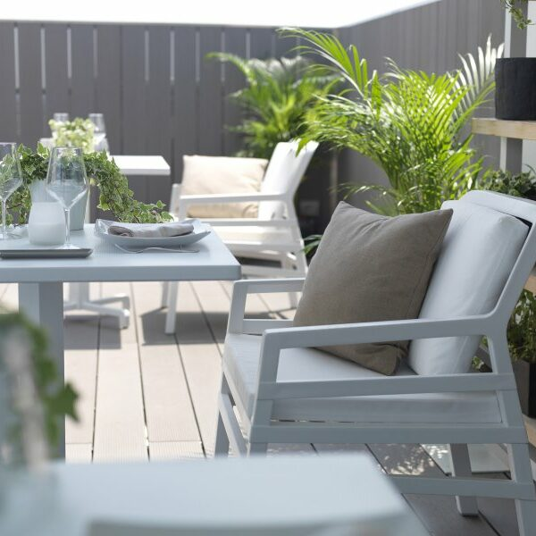 Aria Luxury Patio Armchairs (White with White Cushions) – Pictured in Restaurant Deck Setting