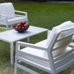 Aria Luxury Patio Armchairs (White with White Cushions) – Pictured in an Outdoor Setting on Lawn