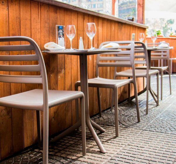 NARDI Costa Bistro Chairs in Taupe with Spritz Table in Taupe in Restaurant
