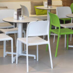 Fiore Table Base (White) in a Cafe Setting