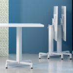 Ibisco Folding Table Bases (White) – Showroom image, Horizontal Stacking in Background