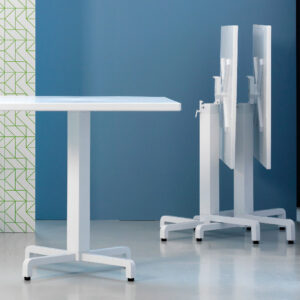 Ibisco Folding Table Bases (White) – Showroom image, Horizontal Stacking in Background