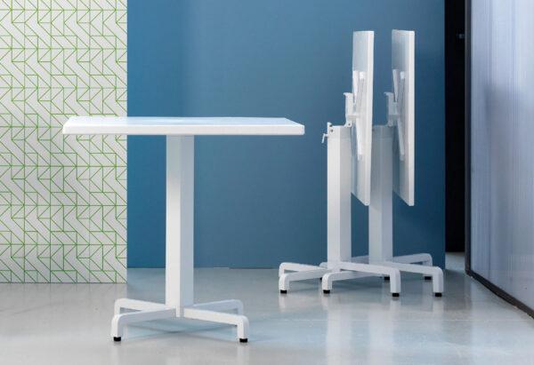 Ibisco Folding Table Bases (White) - Showroom image, Horizontal Stacking in Background