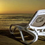 Omega Sun Lounger White & Taupe on beach at sunset