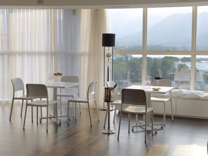 Riva Chairs in White – Pictured in Indoor Restaurant Setting