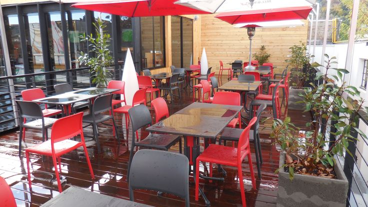 Riva Chairs in a Cafe Setting (Charcoal & Red)