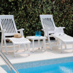Rodi Outdoor Side Table in White between Sun Loungers