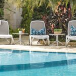 White & Taupe Omega Sun Loungers and Spritz Coffee Tables between pool and garden