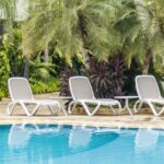 White & Taupe Omega Sun Loungers and Spritz Coffee Tables in poolside garden