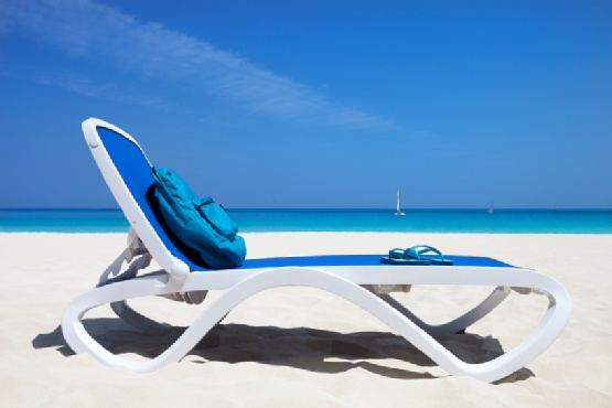 Omega Sun Lounger in Blue & White on a Beach
