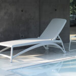 Atlantico Sun Lounger and Pop Table in White next to pool