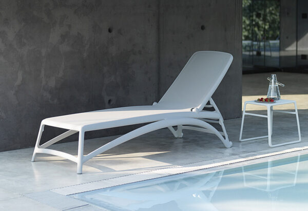 NARDI Atlantico Sun Lounger and Pop Table in White next to pool