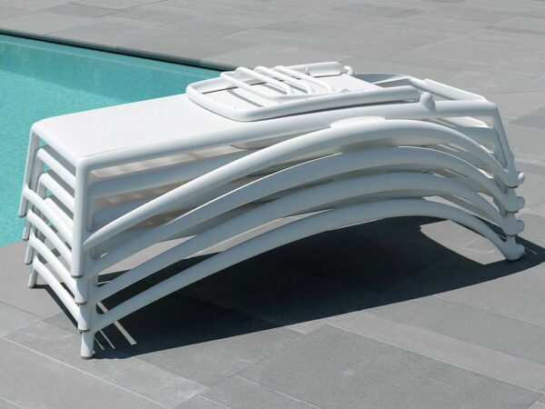 Atlantico Sun Loungers in White Pictured Stacked for Storage by Pool