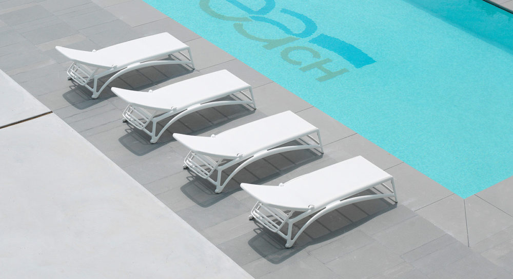 Atlantico Sun Loungers in White – Pictured in a row by Hotel Pool