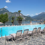 Atlantico Sun Loungers next to hotel pool in Italian mountains