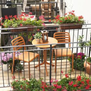 Costa Balcony Setting - Spritz Table & Costa Chairs, Pictured in Orange on Wooden Balcony Setting