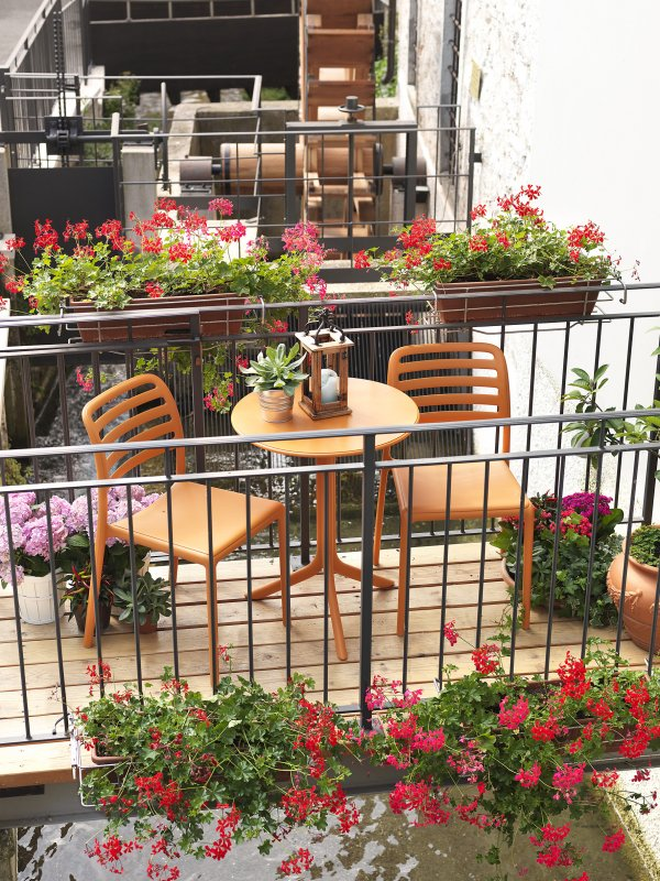 Costa Balcony Setting – Spritz Table & Costa Chairs, Pictured in Orange on Wooden Balcony Setting
