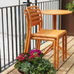 Costa Balcony Setting – Spritz Table & Costa Chairs, Pictured with Chairs Stacked on Apartment Balcony