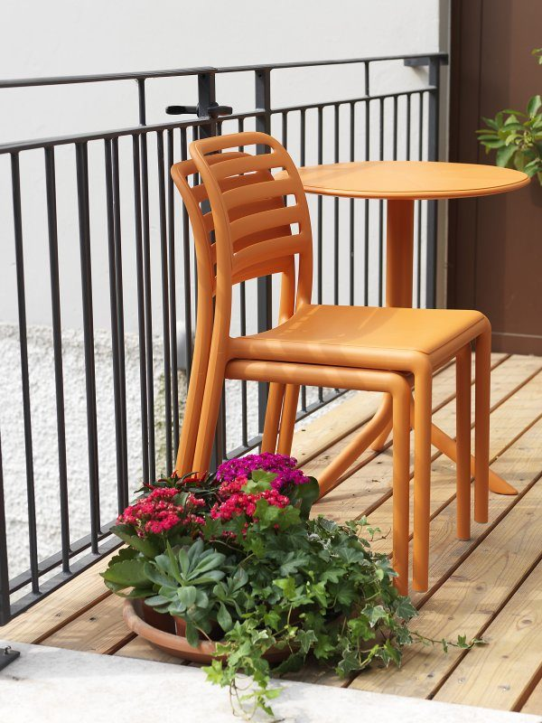 Costa Balcony Setting - Spritz Table & Costa Chairs, Pictured with Chairs Stacked on Apartment Balcony