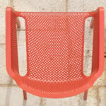 Net Chair in Coral Red (Bird's eye view of seat texture)