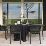 Net Chairs in Charcoal on wooden deck in outdoor dining set next to house