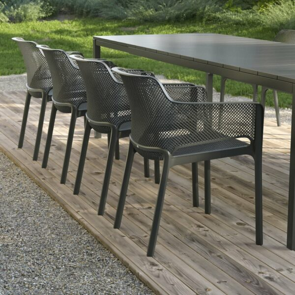 NARDI Net Chairs in Charcoal on wooden deck in outdoor dining setting with Rio Table