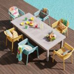 Net Chairs in Mustard Yellow and Spearmint around Levante Table in Taupe next to pool