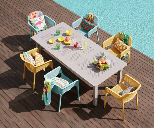 NARDI Net Chairs in Mustard Yellow & Spearmint around Levante Table in Taupe next to pool