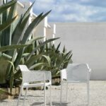 Net Chairs in White in gravel garden with Agave succulents