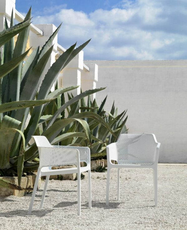 NARDI Net Chairs in White in gravel garden with Agave succulents