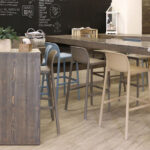 Faro Tall Bar Stools Blue, Taupe and Avana at wooden cafe tables