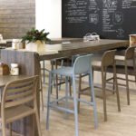 Faro Tall Bar Stools and Costa Bistro Chairs Blue and Taupe in indoor cafe