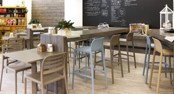 NARDI Faro Tall Bar Stools in indoor café at wooden bench with Costa Bistro Chairs