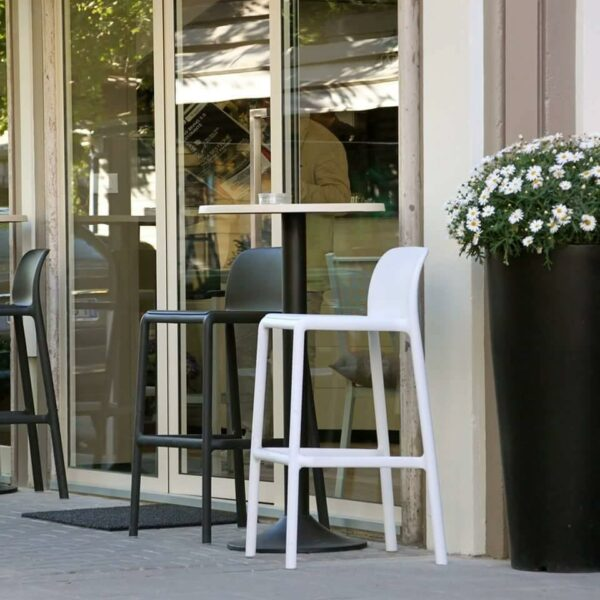 NARDI Faro Tall Bar Stools in White and Charcoal around an outdoor café bar leaner