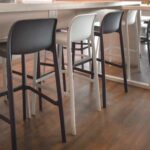 Faro Tall Bar Stools in Charcoal and White at indoor co-working space