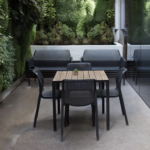 Bit Chairs in Charcoal and Net Benches in outdoor living wall patio area