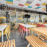Bit Chairs in Mustard and Coral Red in food court