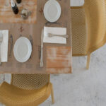 Bit Chairs in Mustard from above with set table
