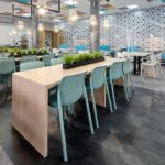 Bit Chairs in Spearmint at wooden tables indoor cafeteria environment