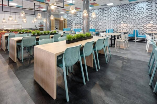 NARDI Bit Chairs in Spearmint at wooden tables indoor cafeteria environment