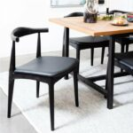 ByDezign Elbow Chair Replica – Black pulled out from table