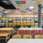 Indoor cafeteria with Bit Chairs in Coral Red & Mustard Yellow